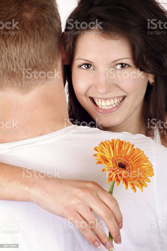 happy woman wiht her boyfriend and a flower royalty-free stock photo