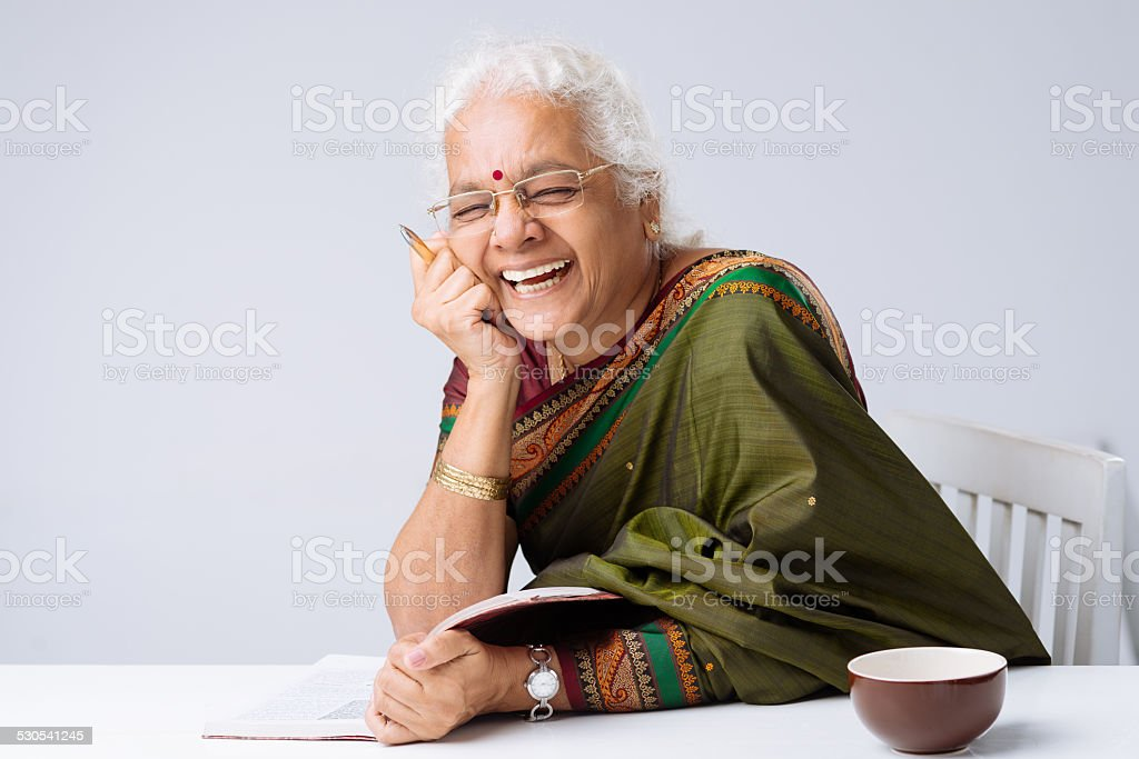 Happy woman with a book stock photo