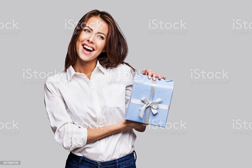 Happy woman with a gift stock photo