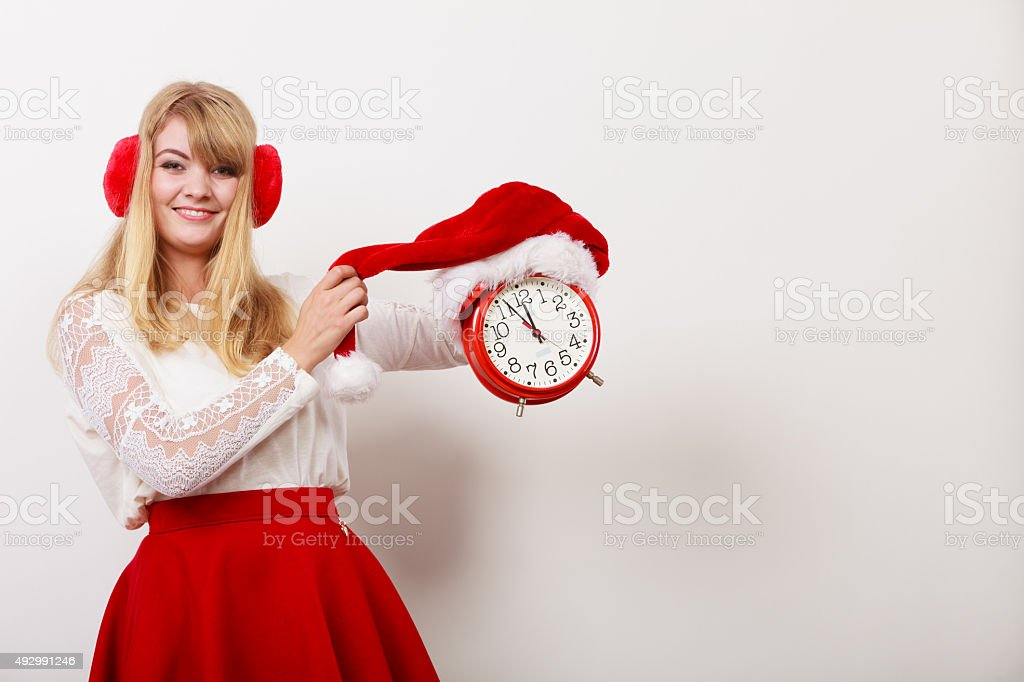 Happy woman with alarm clock. Christmas time. stock photo