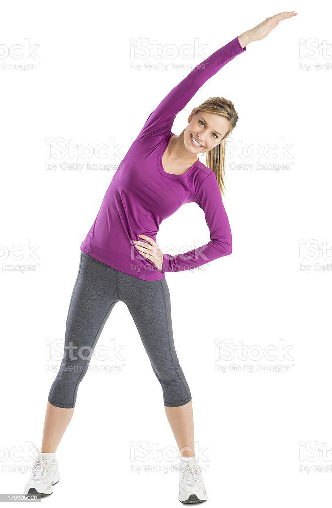 Mujer feliz con brazos planteado haciendo ejercicios de estiramiento - Foto de stock de 20 a 29 años libre de derechos