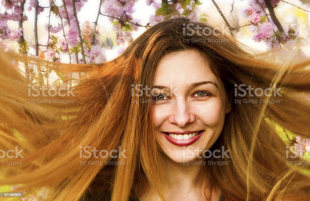 Happy woman with beautiful long hair and flowers royalty-free stock photo