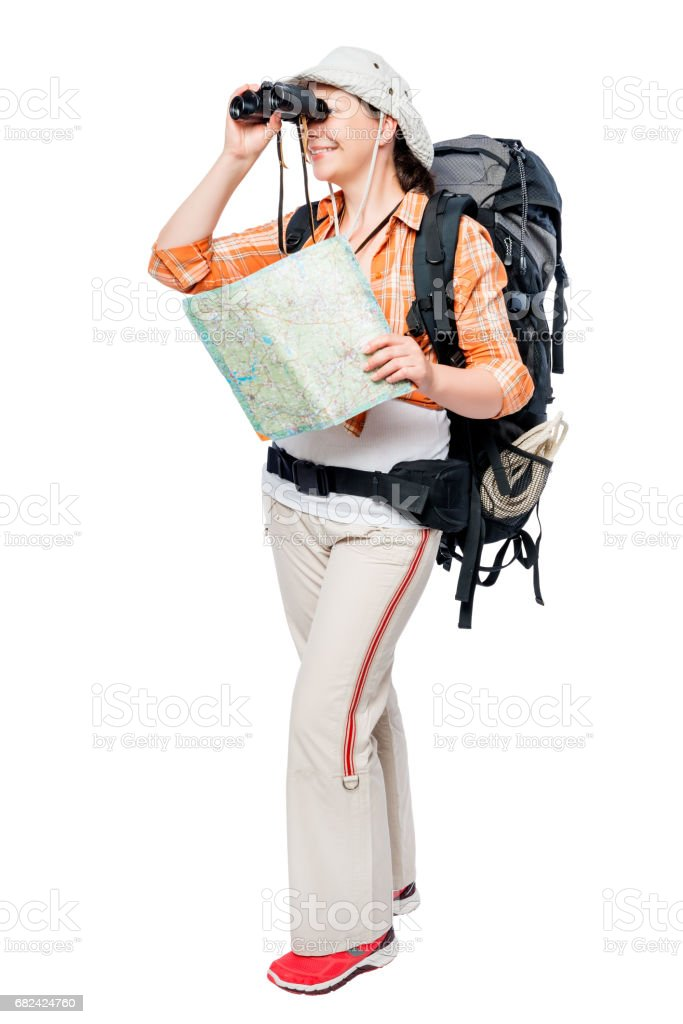 happy woman with binoculars and a map in the campaign, portrait on a white background royalty-free stock photo