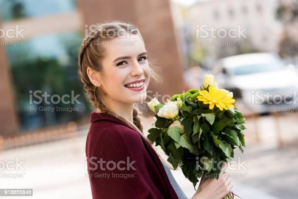 Happy woman with bouquet of flowers picture id918855848?b=1&k=6&m=918855848&s=612x612&h=i209lho3srsvt9lxng9cxkqwtmdtt3l5g7mmpa xxvu=