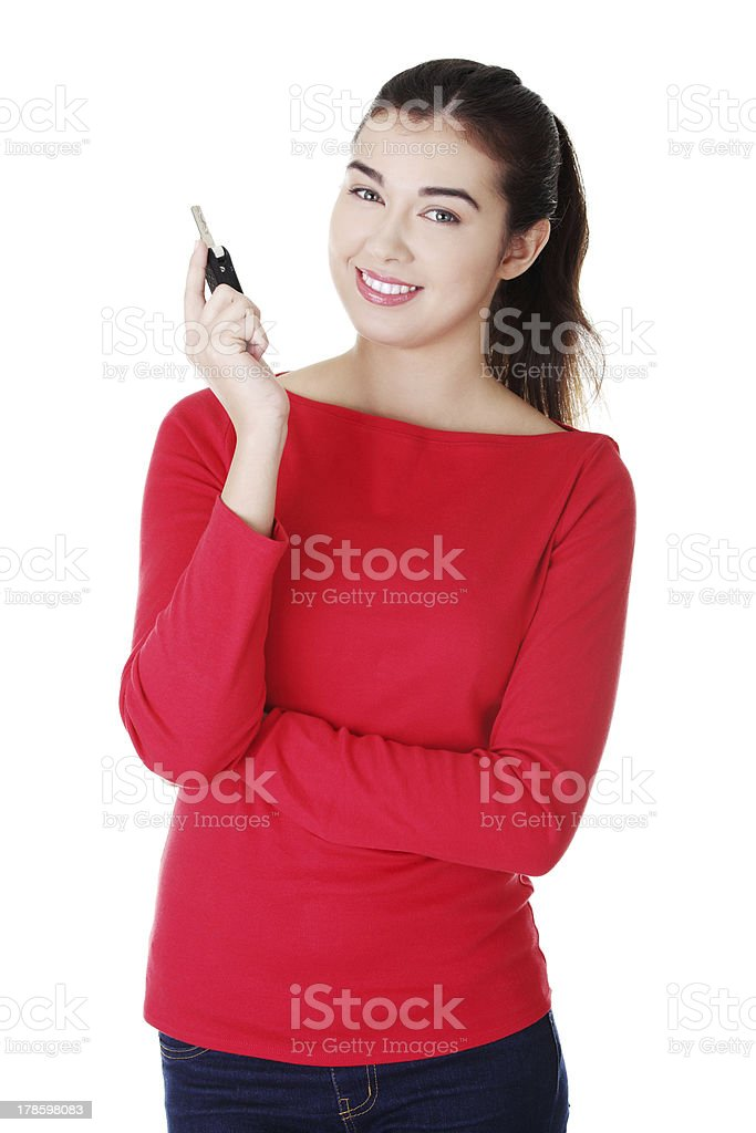 Happy woman with car key stock photo
