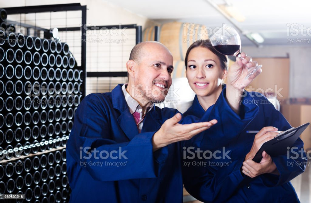Happy woman with cardboard standing with worker stock photo