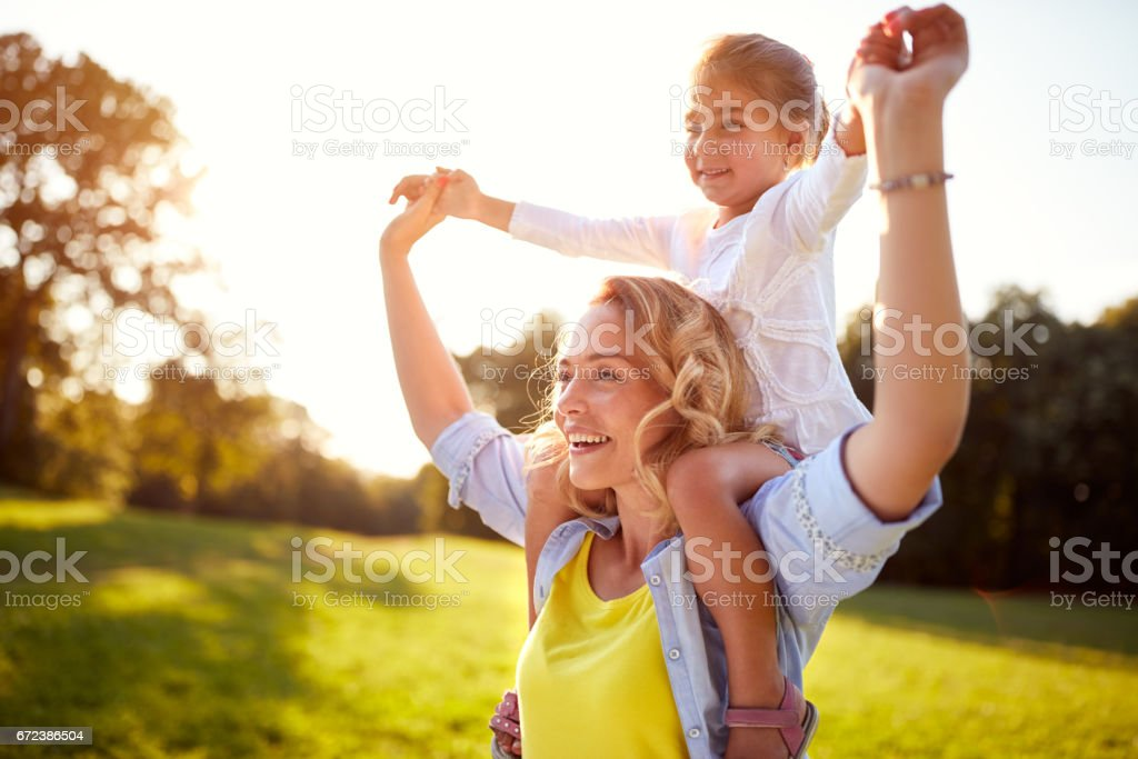Happy woman with child together outdoor stock photo