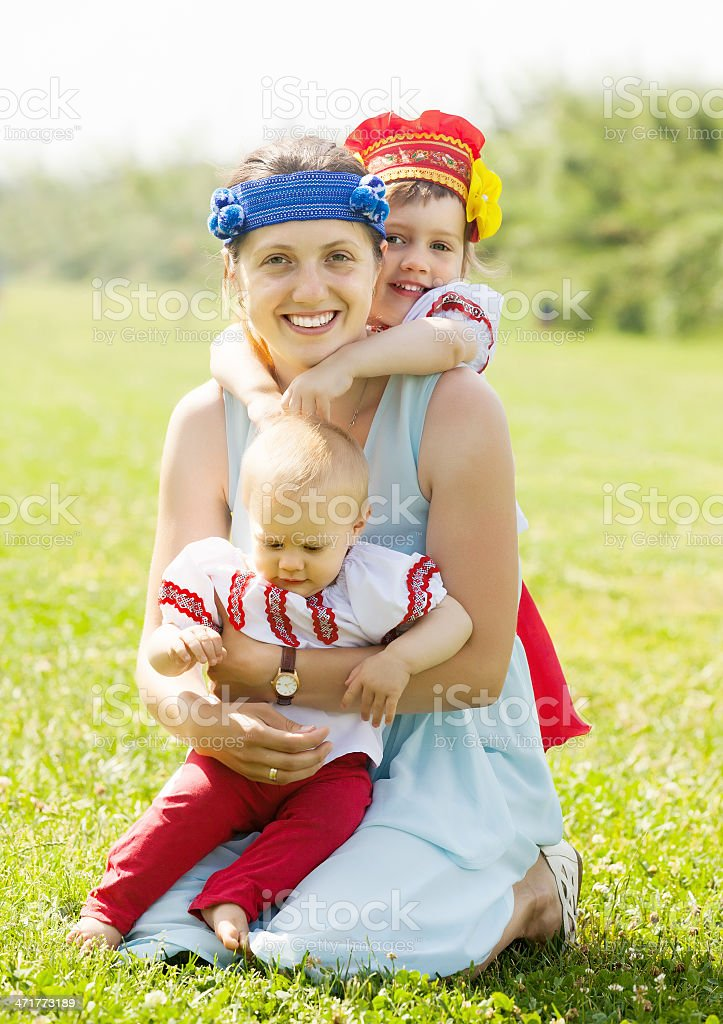 happy  woman with  children in russian folk clothes royalty-free stock photo