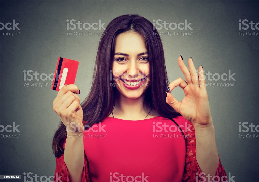 happy woman with credit card giving ok hand sign gesture 免版稅 stock photo