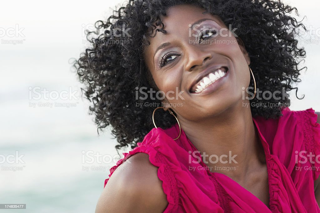 Happy Woman With Curly Hair Looking Away royalty-free stock photo