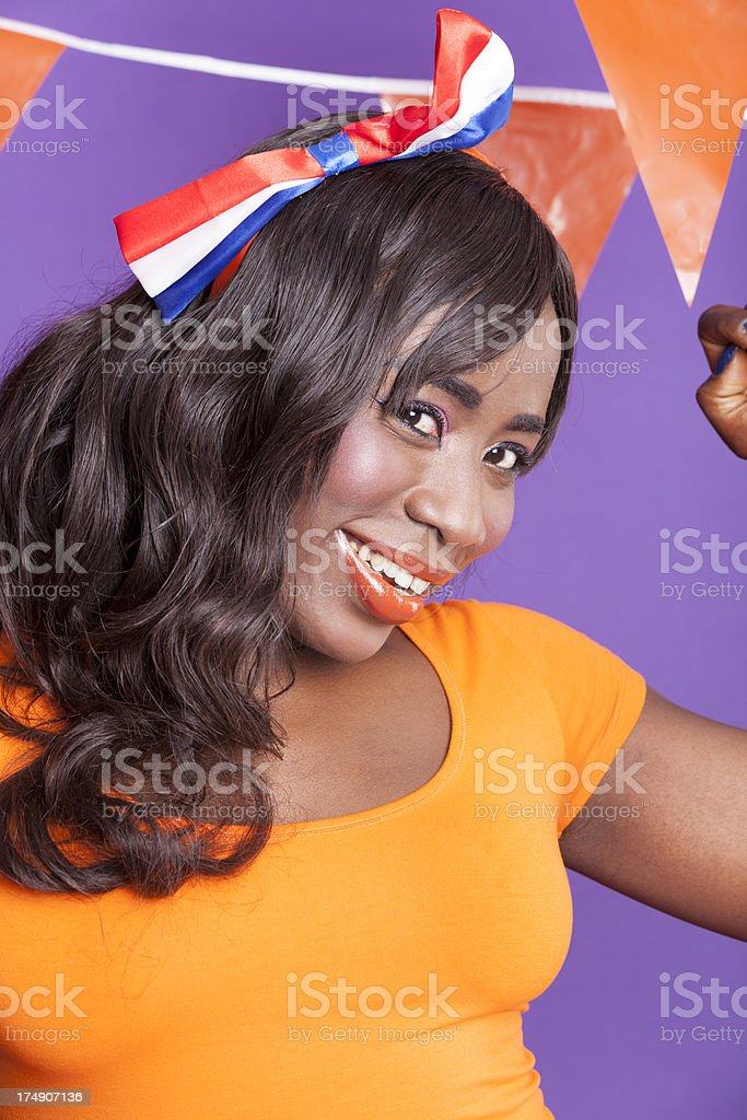 Happy woman with Dutch flags stock photo