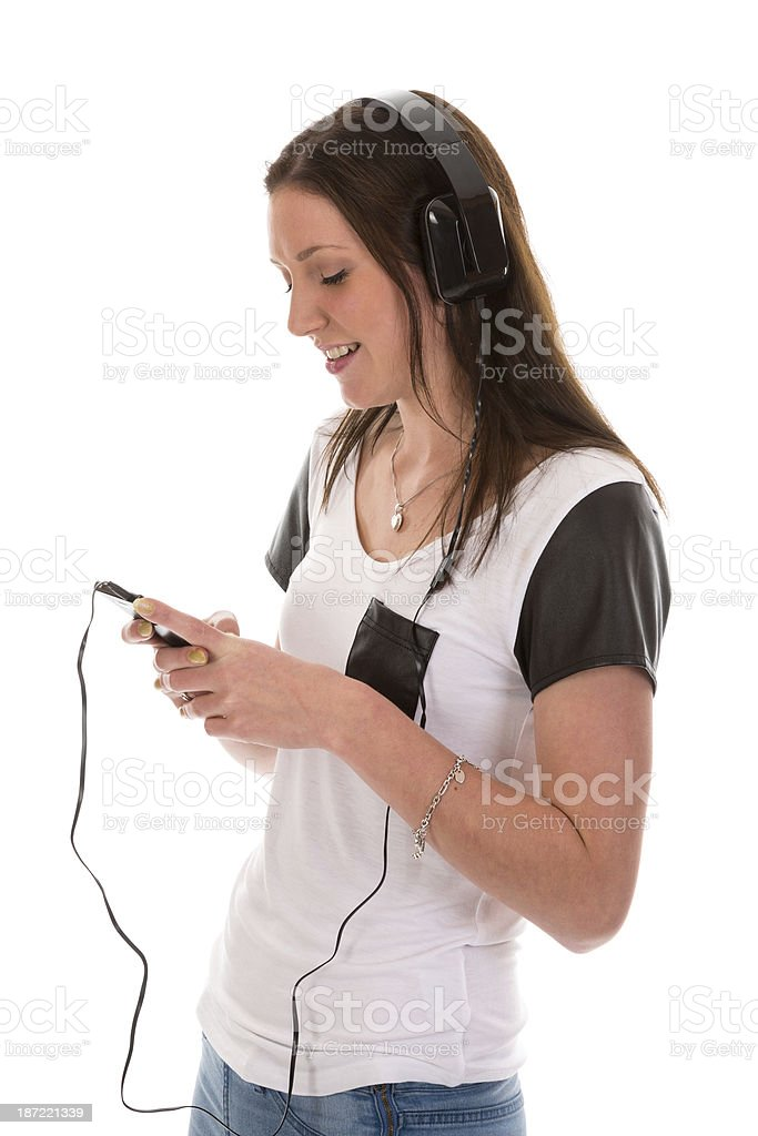 Happy woman with headphones listening to music of her telephone royalty-free stock photo