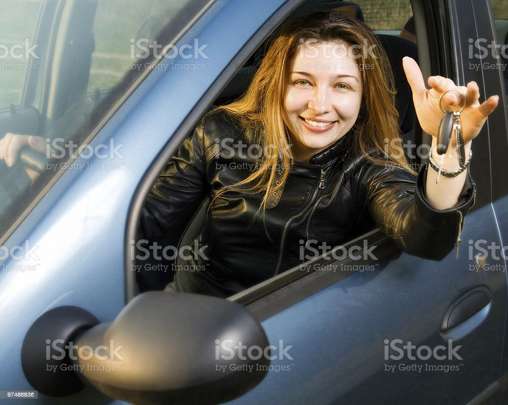 Happy woman with keys from her new car royalty-free stock photo