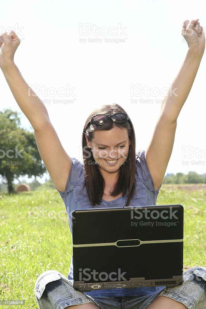 happy woman with laptop stock photo