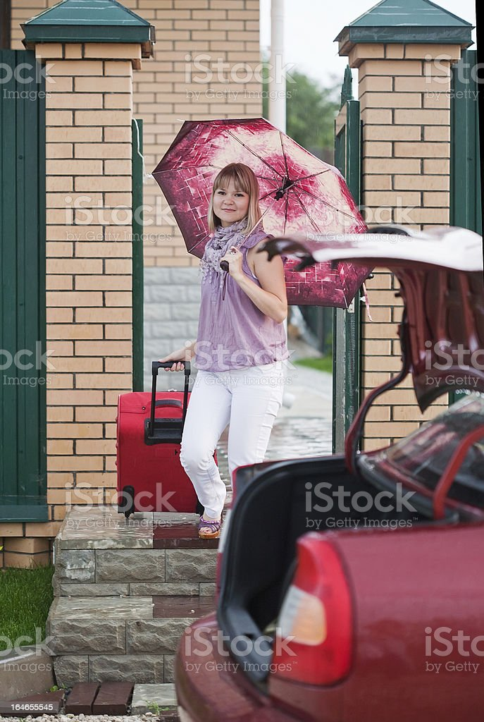 Happy woman with luggage royalty-free stock photo