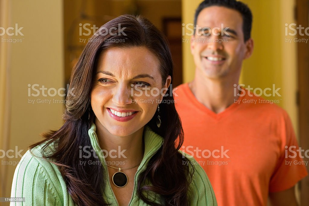 Happy Woman With Man In Background royalty-free stock photo