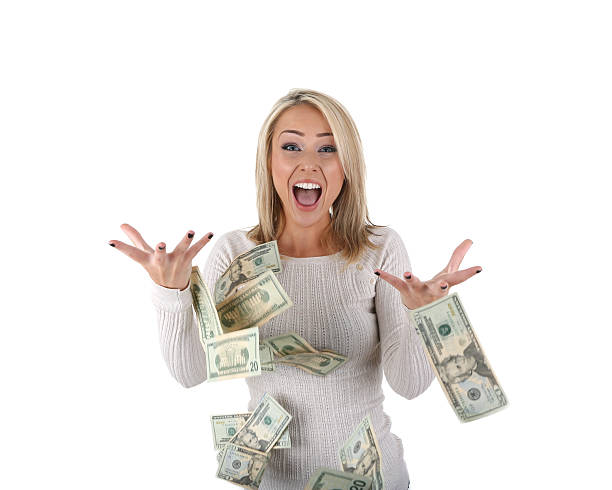 happy woman with money - throw money away stock pictures, royalty-free photos & images