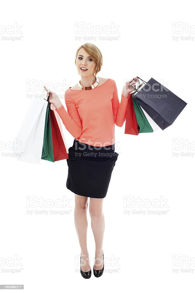 Happy woman with shopping bags royalty-free stock photo