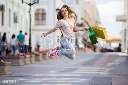 615594632 istock photo Happy woman with shopping bags 488870616