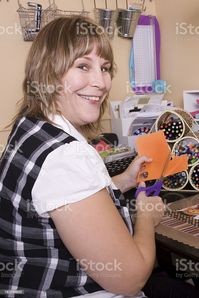 Happy woman working on scrapbook royalty-free stock photo
