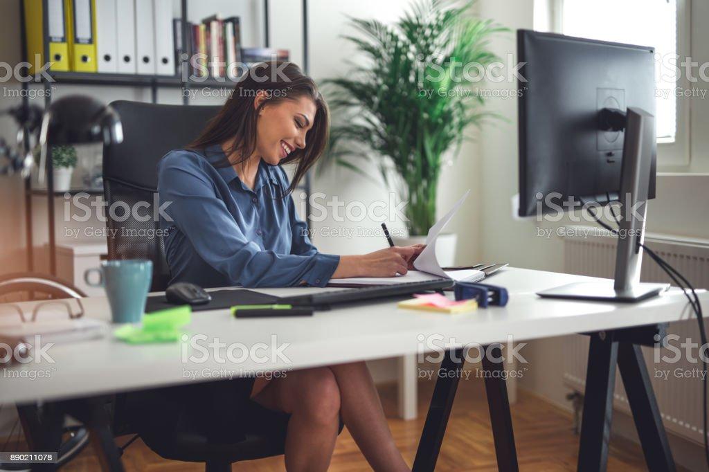 Happy woman working stock photo