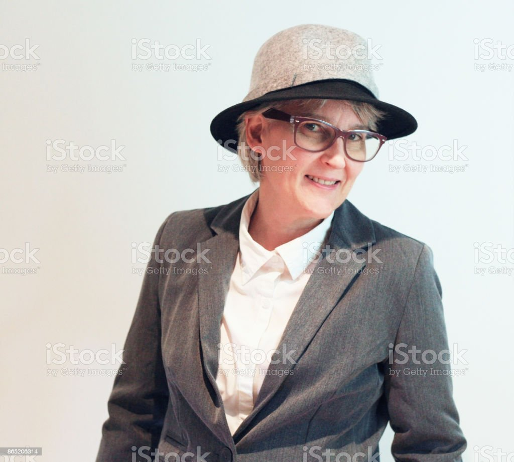 Happy woman,dress in grey suit and hat. - Royalty-free Adult Stock Photo