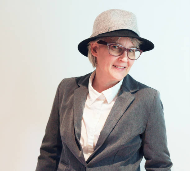 Happy woman,dress in grey suit and hat. stock photo