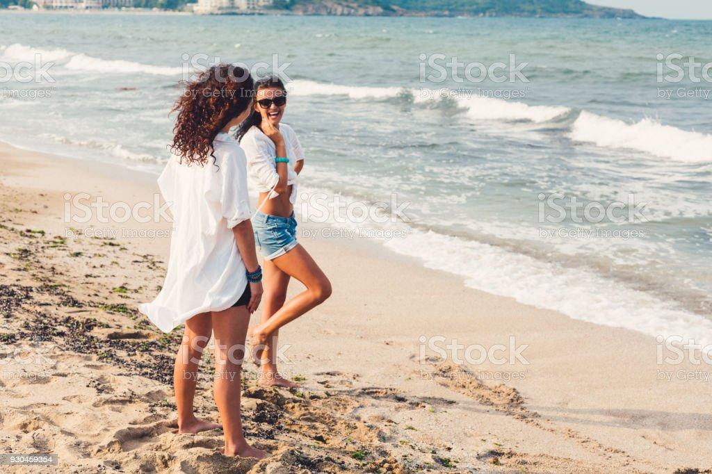 Happy women at the beach stock photo