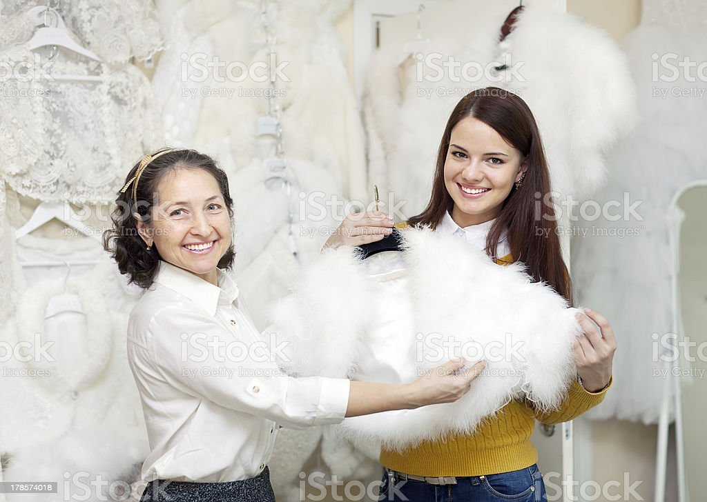 happy women chooses bridal outfit royalty-free stock photo