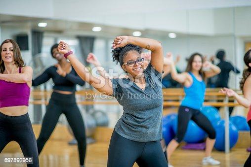 897892972 istock photo Happy Women Dancing 897892956