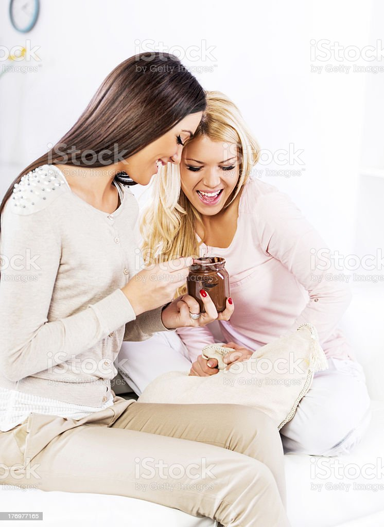 Happy women eating chocolate. royalty-free stock photo