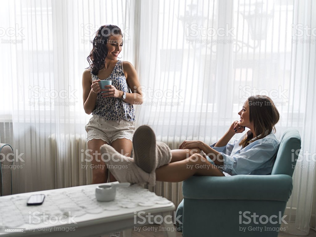 Happy women enjoying in living room and communicating. royalty-free stock photo