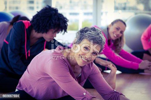 istock Happy women exercising 665667694