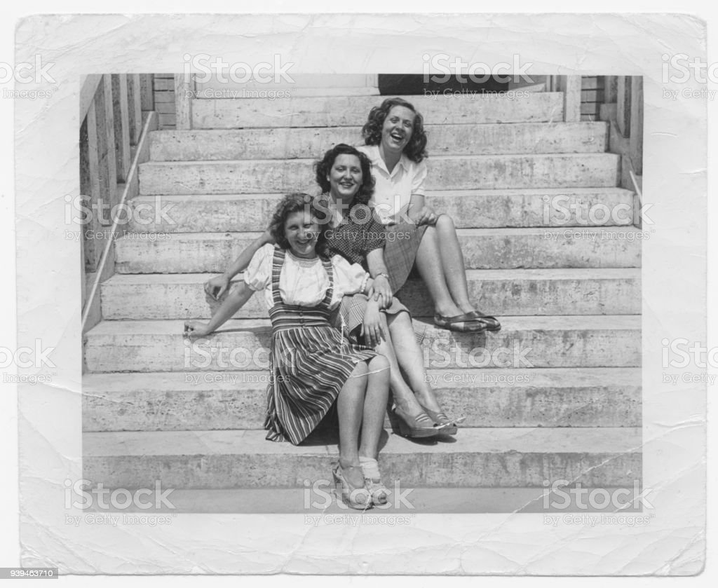 Happy women friends in 1945 stock photo