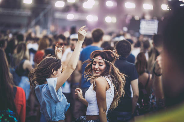 happy women having fun while dancing on a music festival. - dance music stock pictures, royalty-free photos & images