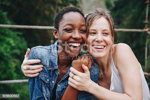Happy women hugging each other