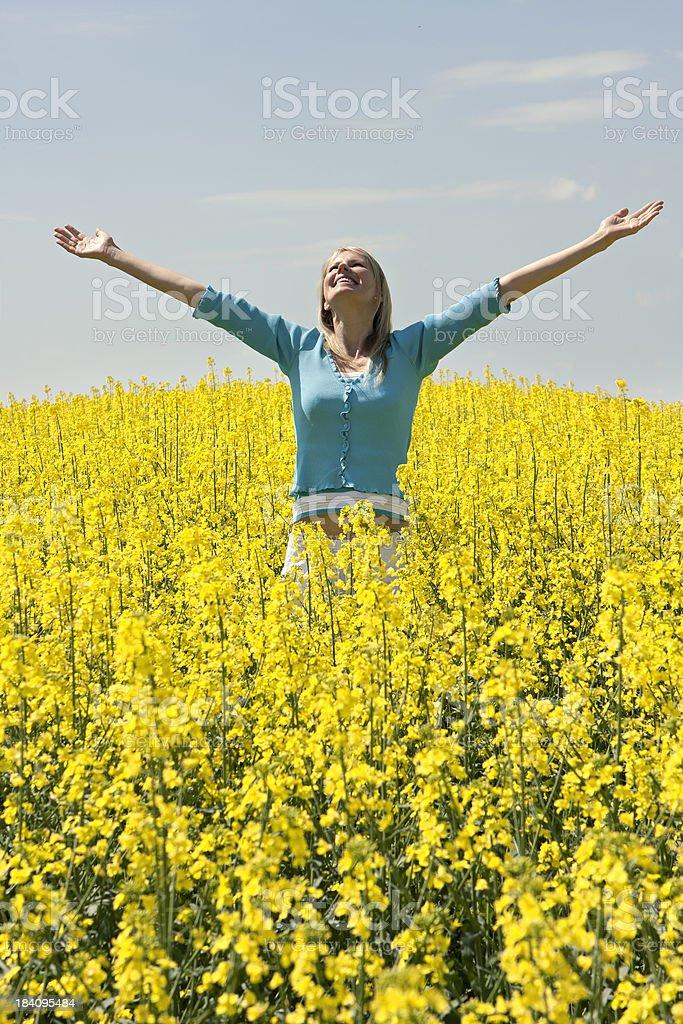 Happy women in rape field royalty-free stock photo
