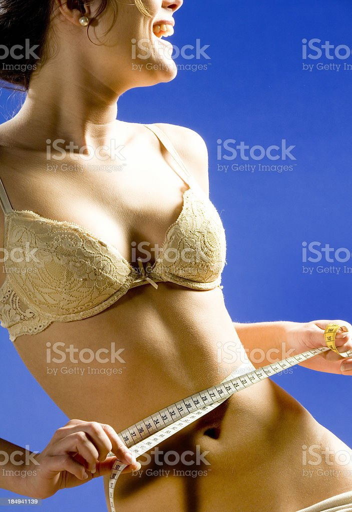 happy women measuring hips royalty-free stock photo