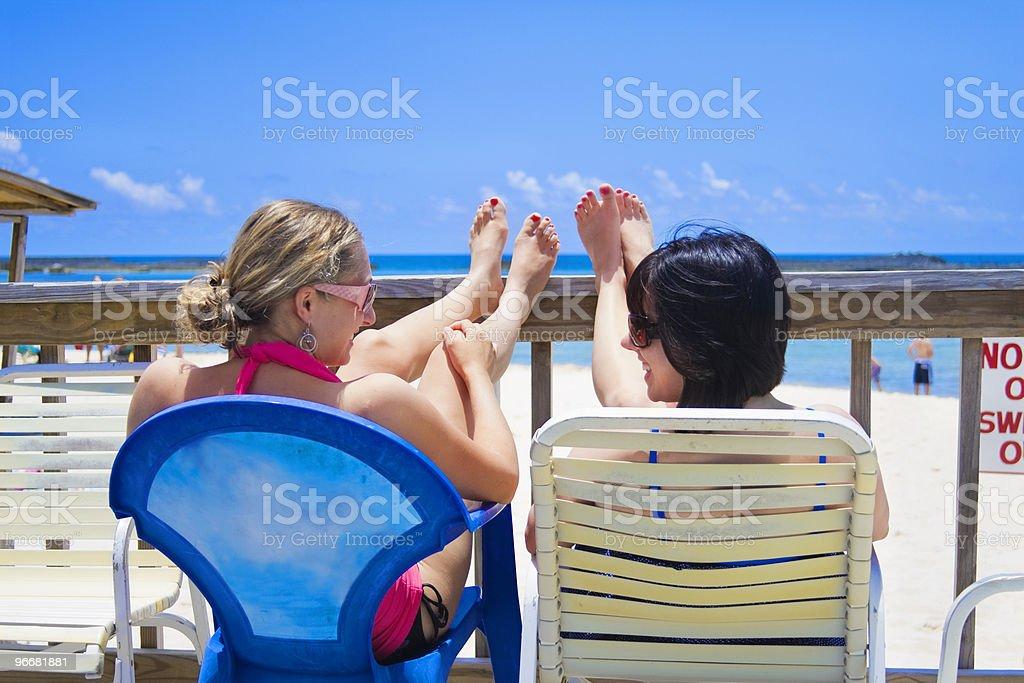 Happy Women on Vacation Sunbathing royalty-free stock photo