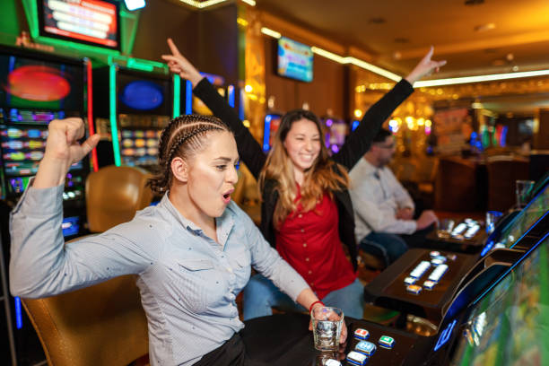 244 Cheerful Female Casino Players At Slot Machines Europe Stock Photos,  Pictures & Royalty-Free Images - iStock