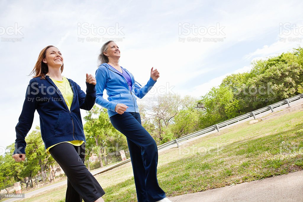 Happy Women Running Together on a Trail royalty-free stock photo
