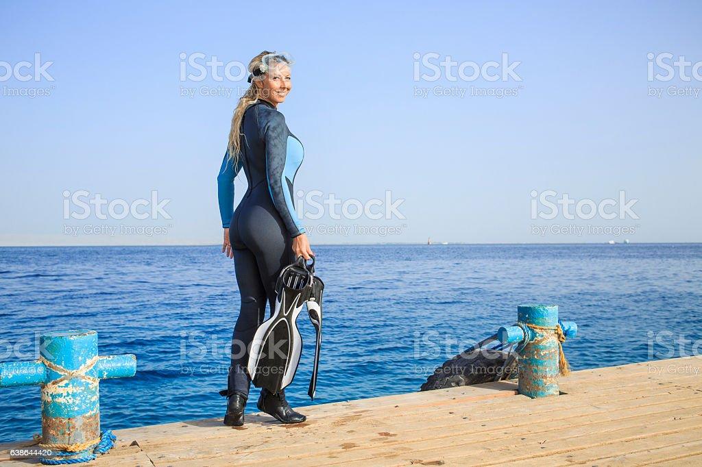 Happy women scuba diver enjoying in the sea stock photo