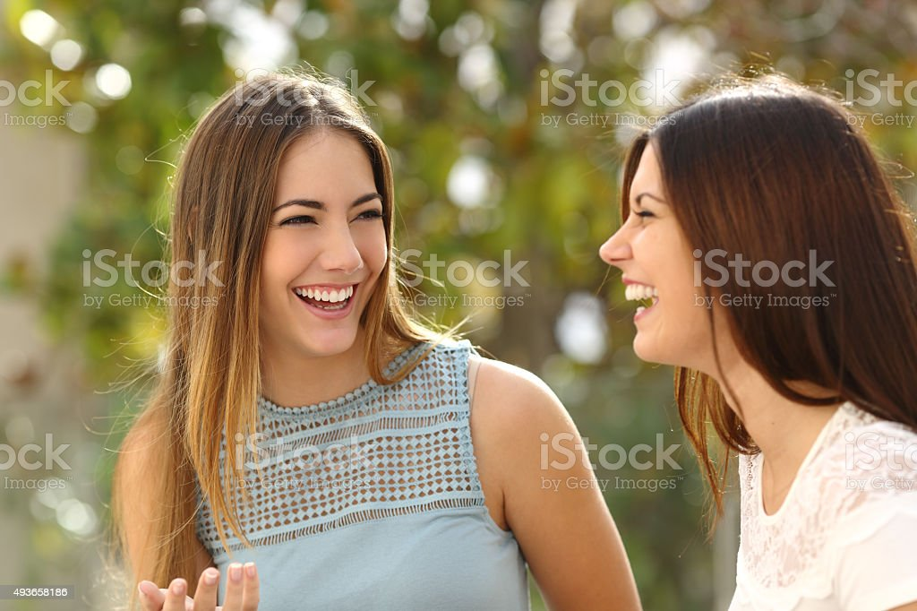 Happy women talking and laughing stock photo