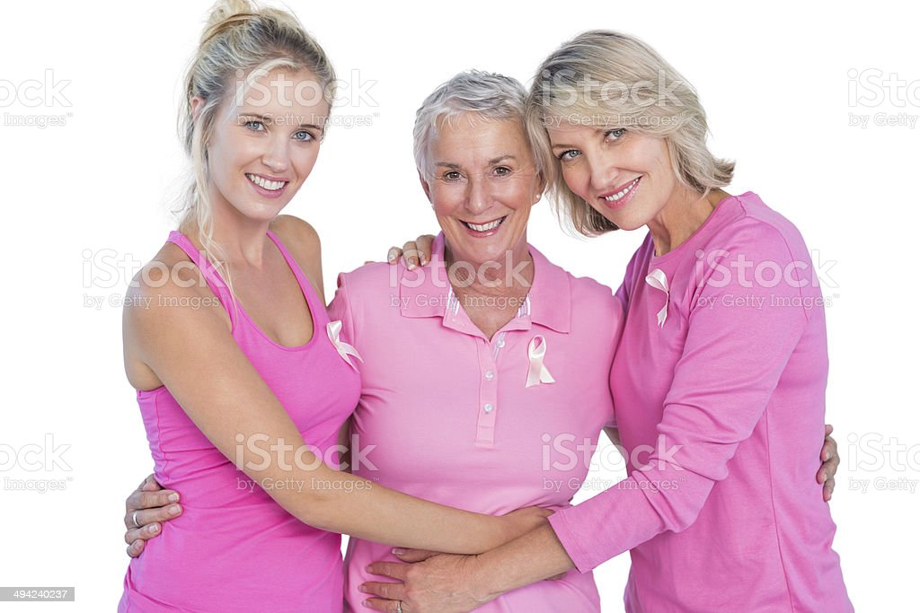 Happy women wearing pink tops and ribbons for breast cancer stock photo