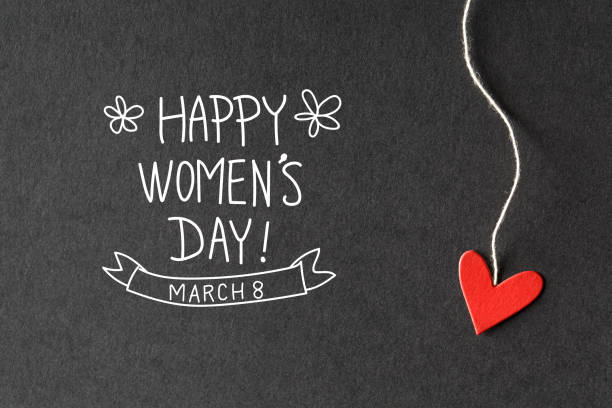Happy Women's Day message with paper hearts stock photo