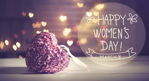 Happy Womens Day message with pink heart stock photo