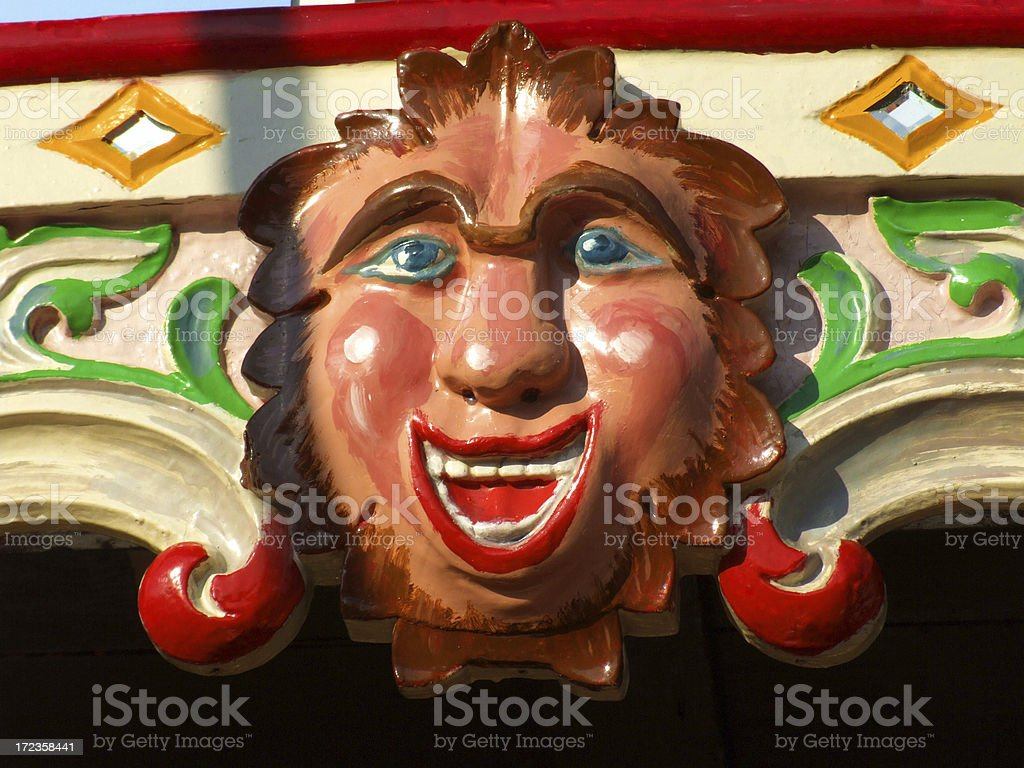 Happy wooden face in evening sunlight royalty-free stock photo