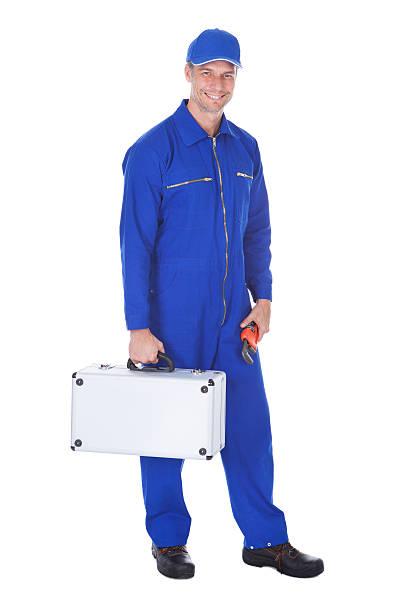 happy worker holding toolkit und schraubenschlüssel - jumpsuit blau stock-fotos und bilder