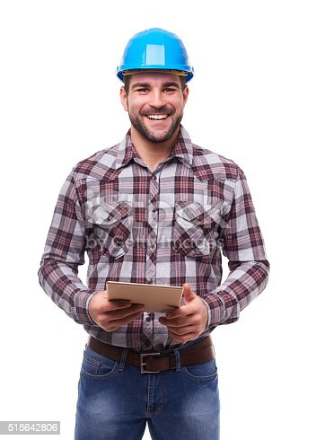 istock Happy worker in blue helmet using a digital tablet 515642806