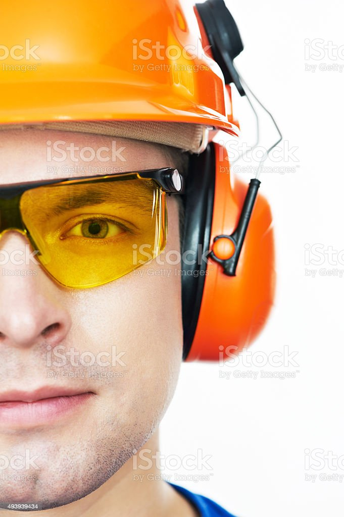 Happy worker in hardhat and overall with thumb up stock photo